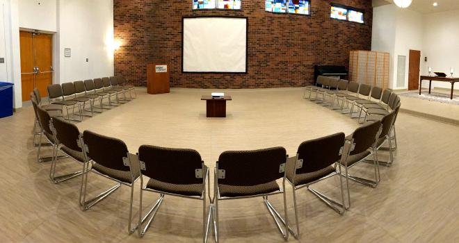 Chairs configured around projection screen